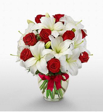 Uşak hediye çiçek yolla  1 dal kazablanka 11 adet kırmızı gül vazosu